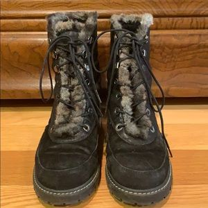 Stuart Weitzman combat boots fully lined in fur